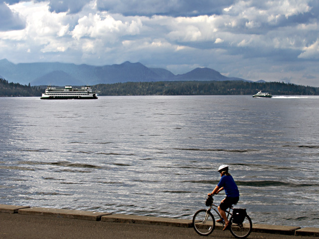 Scenic Washington, Puget Sound, Biker and Boats from Alki Avenue West Seattle