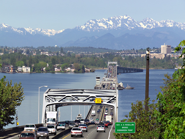 Evergreen Floating Bridge crosses Lake Washington seeing the Olympic Mountains
