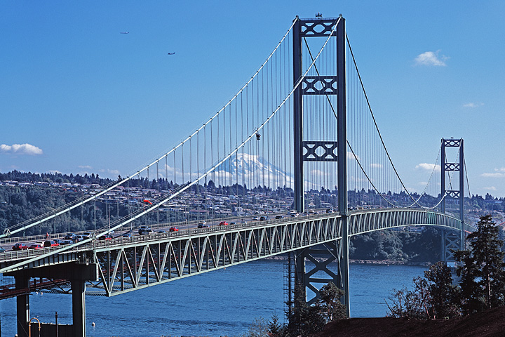 Tacoma Narrows Suspension Bridge; Mt. Rainier; planes passing from Seatack airport
